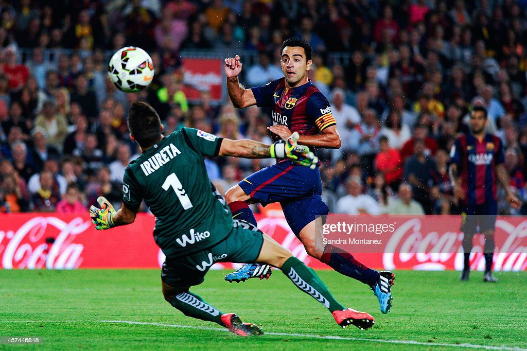 <a gi-track='captionPersonalityLinkClicked' href=/galleries/search?phrase=Xavi+Hernandez+-+Soccer+Player&family=editorial&specificpeople=2834438 ng-click='$event.stopPropagation()'>Xavi Hernandez</a> of FC Barcelona scores the opening goal past Xabi Irureta of SD Eibar during the La Liga match between FC Barcelona and SD Eibar at Camp Nou on October 18, 2014 in Barcelona, Spain.