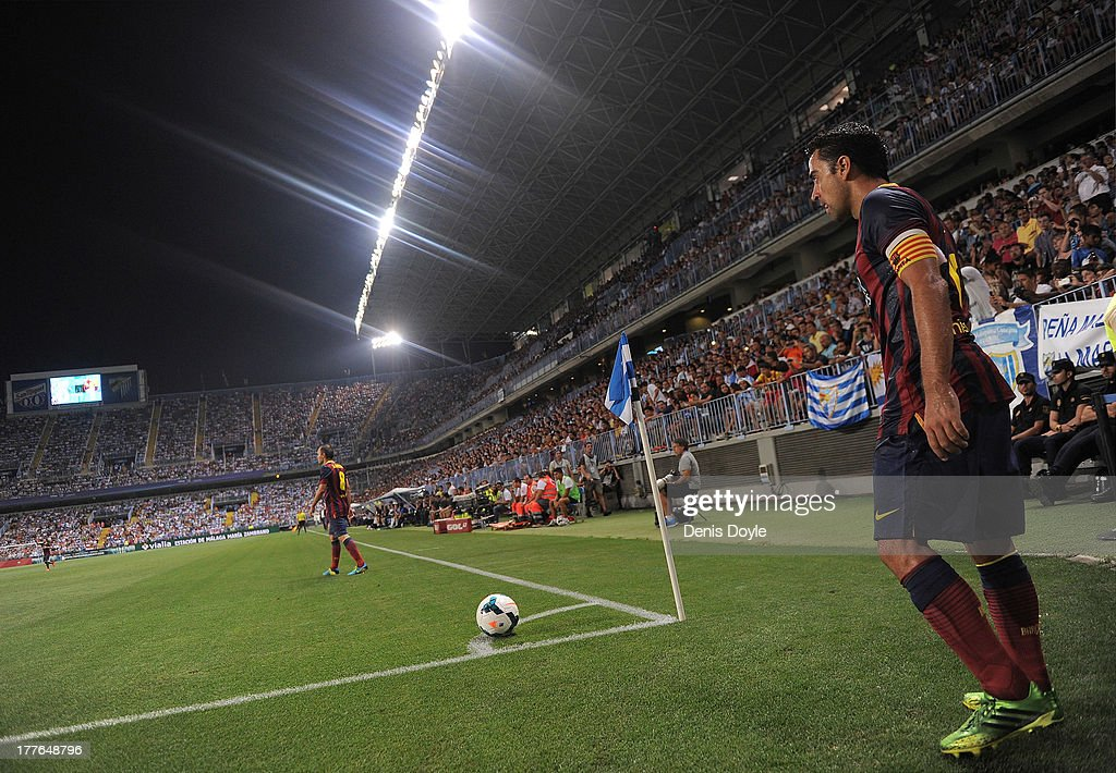 Xavi Hernandez of FC Barcelona takes a corner kick during the La Liga match between Malaga CF and FC Barcelona at La Rosaleda Stadium on August 25, 2013 in Malaga, Spain.
