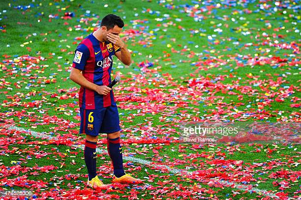 Xavi Hernandez of FC Barcelona wipes his tears at the end of the La Liga match between FC Barcelona and RC Deportivo de la Coruna at Camp Nou on May...