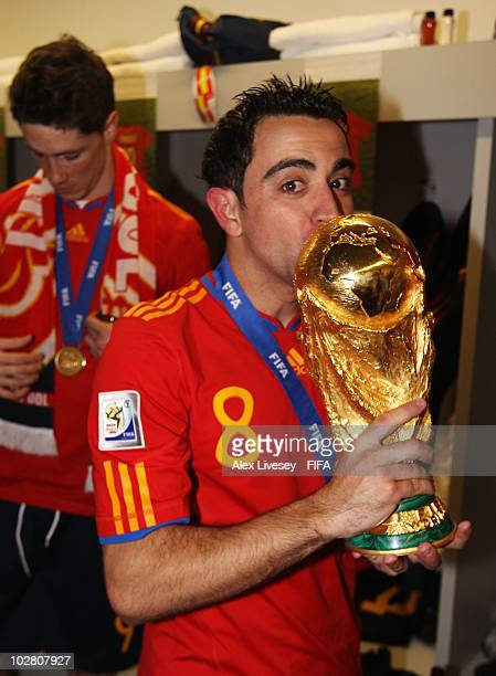Xavi Hernandez of Spain celebrates in the Spanish dressing room after they won the 2010 FIFA World Cup at Soccer City Stadium on July 11 2010 in...