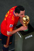 Xavi Hernandez of Spain kisses the World Cup as he collects his medal during the 2010 FIFA World Cup South Africa Final match between Netherlands and...