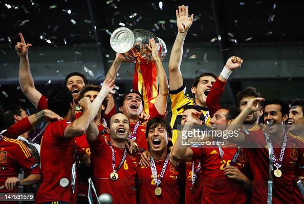 Xavi Hernandez of Spain lifts the trophy as he celebrates with teammates following victory in the UEFA EURO 2012 final match between Spain and Italy...
