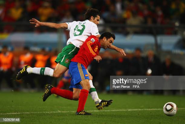 Xavi Hernandez of Spain vies with Tiago of Portugal during the 2010 FIFA World Cup South Africa Round of Sixteen match between Spain and Portugal at...