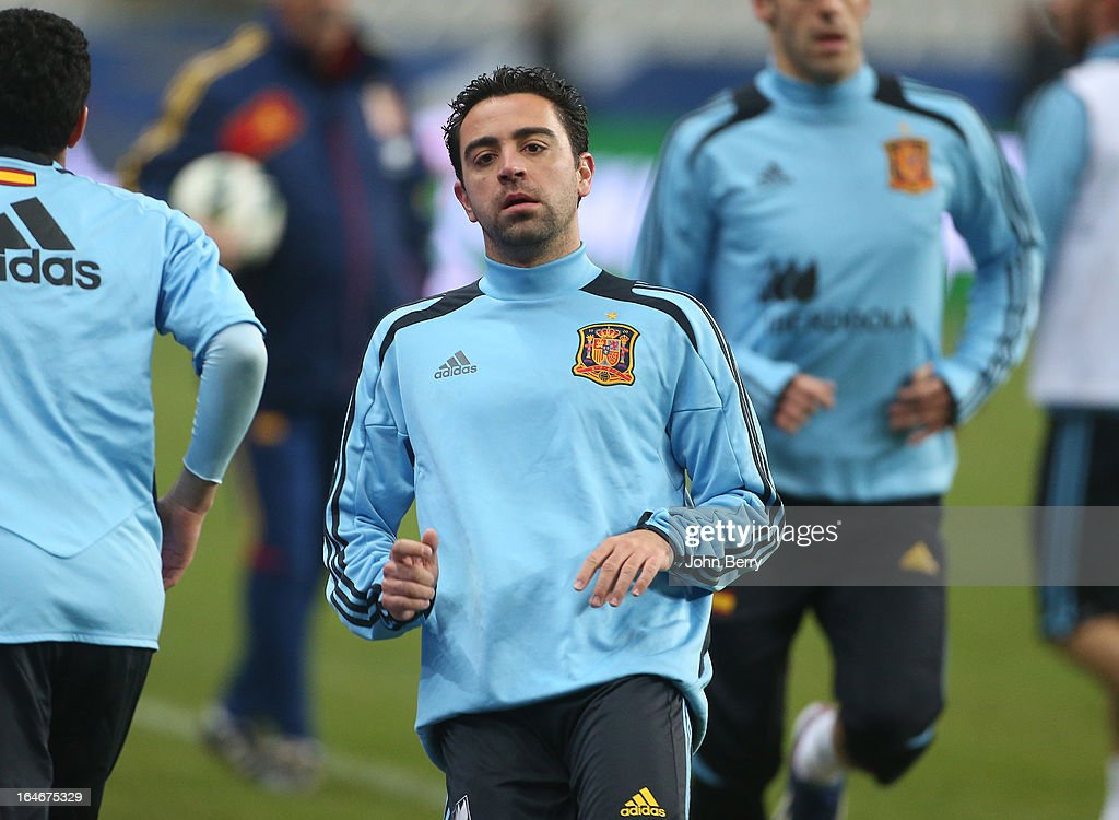 <a gi-track='captionPersonalityLinkClicked' href=/galleries/search?phrase=Xavi+Hernandez+-+Soccer+Player&family=editorial&specificpeople=2834438 ng-click='$event.stopPropagation()'>Xavi Hernandez</a> of Spain warms up during the practice session the day before the FIFA World Cup 2014 qualifier between France and Spain at the Stade de France on March 25, 2013 in Saint-Denis near Paris, France.