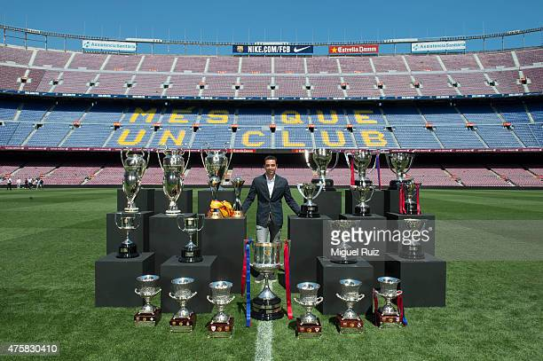 Xavi Hernandez poses with the twentyfour trophies that he has won during his career with FC Barcelona ahead of his final game for the club at Camp...