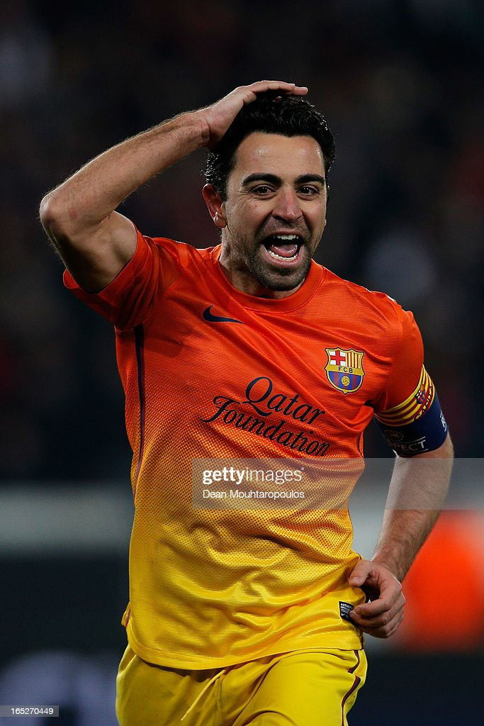 Xavi of Barcelona celebrates scoring a penalty for his teams second goal during the UEFA Champions League Quarter Final match between Paris Saint-Germain and Barcelona FCB at Parc des Princes on April 2, 2013 in Paris, France.
