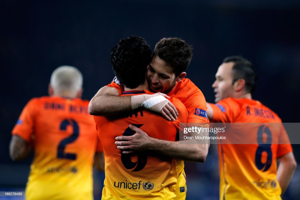Xavi (#6) of Barcelona celebrates scoring a penalty for his teams second goal with <a gi-track='captionPersonalityLinkClicked' href=/galleries/search?phrase=Jordi+Alba&family=editorial&specificpeople=5437949 ng-click='$event.stopPropagation()'>Jordi Alba</a> during the UEFA Champions League Quarter Final match between Paris Saint-Germain and Barcelona FCB at Parc des Princes on April 2, 2013 in Paris, France.