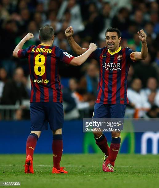 Xavi of Barcelona celebrates victory with Andres Iniesta after the La Liga match between Real Madrid CF and FC Barcelona at the Bernabeu on March 23...