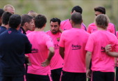 Xavi of Barcelona looks on during the Barcelona Training Session at St George's Park on July 28 2014 in BurtonuponTrent England
