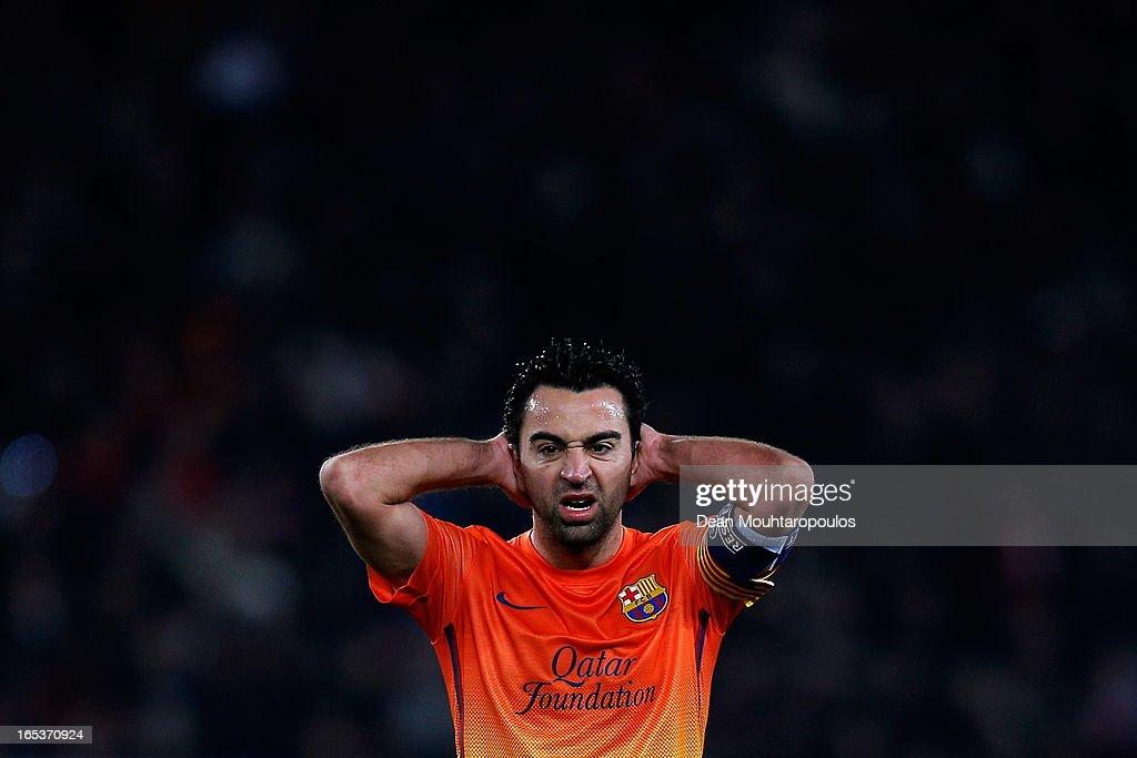 Xavi of Barcelona reacts to a missed chance during the UEFA Champions League Quarter Final match between Paris Saint-Germain and Barcelona FCB at Parc des Princes on April 2, 2013 in Paris, France.