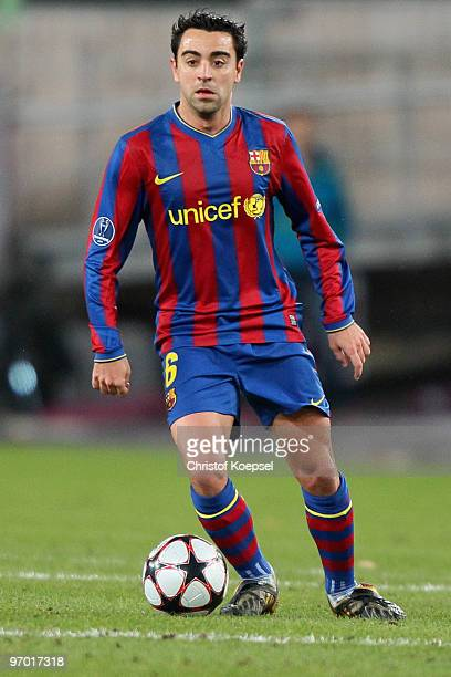 Xavi of Barcelona runs with the ball during the UEFA Champions League round of sixteen first leg match between VfB Stuttgart and FC Barcelona at...