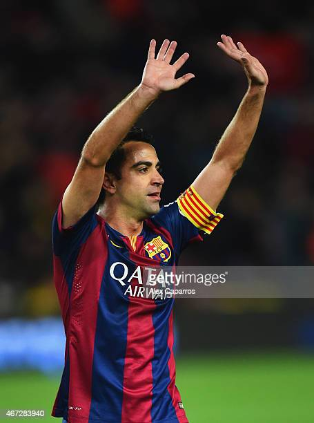 Xavi of Barcelona salutes the crowd after victory in the La Liga match between FC Barcelona and Real Madrid CF at Camp Nou on March 22 2015 in...