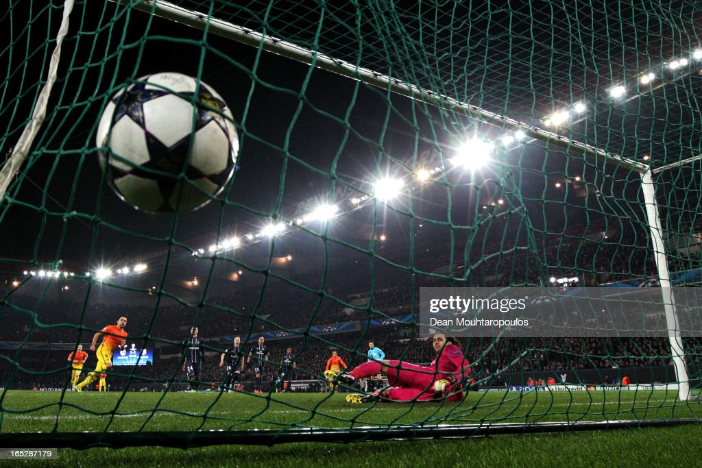 Xavi of Barcelona takes and scores a penalty for his teams second goal past goal keeper, <a gi-track='captionPersonalityLinkClicked' href=/galleries/search?phrase=Salvatore+Sirigu&family=editorial&specificpeople=5969515 ng-click='$event.stopPropagation()'>Salvatore Sirigu</a> of PSG during the UEFA Champions League Quarter Final match between Paris Saint-Germain and Barcelona FCB at Parc des Princes on April 2, 2013 in Paris, France.