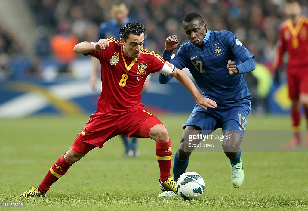 Xavi of Spain (L) in action with <a gi-track='captionPersonalityLinkClicked' href=/galleries/search?phrase=Blaise+Matuidi&family=editorial&specificpeople=801779 ng-click='$event.stopPropagation()'>Blaise Matuidi</a> of France during a FIFA 2014 World Cup Qualifier between France and Spain at Stade de France on March 26, 2013 in Paris, France.