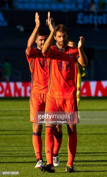 Xavi Prieto of Real Sociedad and Raul Navas of Real Sociedad celebrate the victory after the La Liga match between Celta de Vigo and Real Sociedad at...