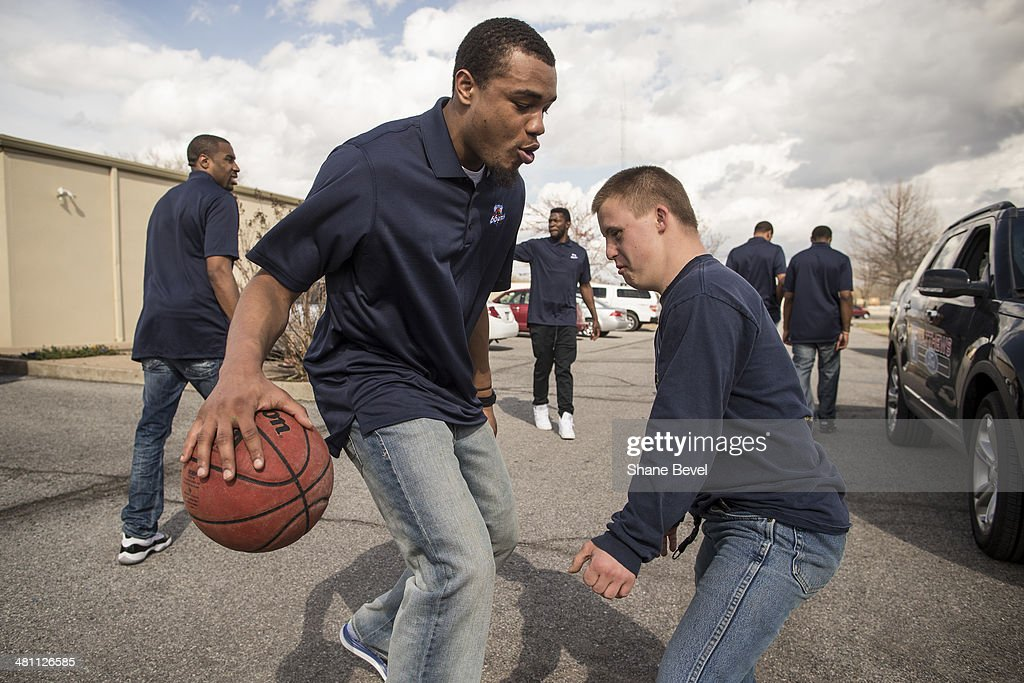 Xavier Alexander of the Tulsa 66ers plays a little pickup basketball with Blake Nay during the NBA D-League community relations event at A New Leaf, a non-profit that employs adults with developmental disabilities, on March 27, 2014 in Broken Arrow, Oklahoma.