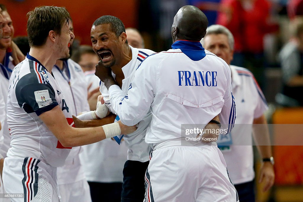 <a gi-track='captionPersonalityLinkClicked' href=/galleries/search?phrase=Xavier+Barachet&family=editorial&specificpeople=4312948 ng-click='$event.stopPropagation()'>Xavier Barachet</a>, assistant coach <a gi-track='captionPersonalityLinkClicked' href=/galleries/search?phrase=Didier+Dinart&family=editorial&specificpeople=710241 ng-click='$event.stopPropagation()'>Didier Dinart</a> and Alix Nyokas of France celebrate after the semi final match between Spain and France at Lusail Multipurpose Hall during the Men's Handball World Championship on January 30, 2015 in Doha, Qatar. The match between Spain and France ended 22-26.