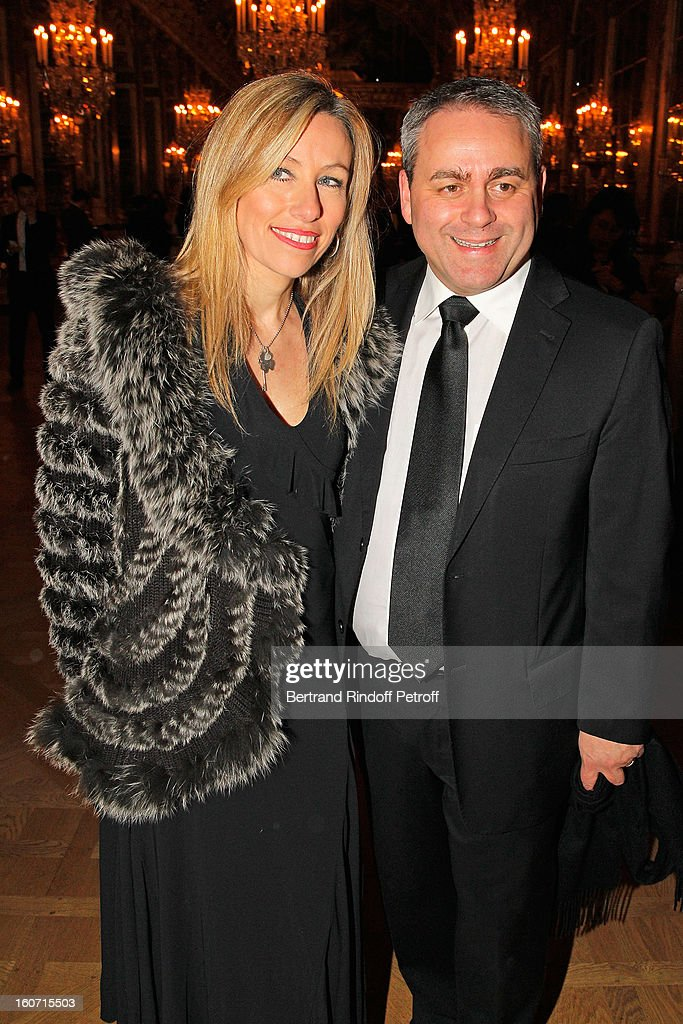 <a gi-track='captionPersonalityLinkClicked' href=/galleries/search?phrase=Xavier+Bertrand&family=editorial&specificpeople=584441 ng-click='$event.stopPropagation()'>Xavier Bertrand</a> (R) and his wife Emmanuelle pose in the Hall of Mirrors as they attend the gala dinner of Professor David Khayat's association 'AVEC', at Chateau de Versailles on February 4, 2013 in Versailles, France.