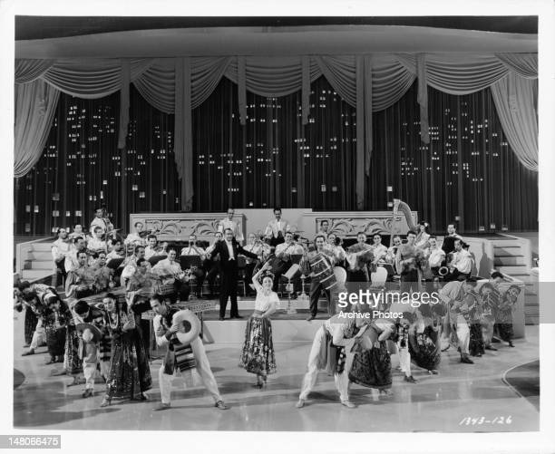Xavier Cugat and his rumba band perform in a scene from the film 'WeekEnd At The Waldorf' 1945