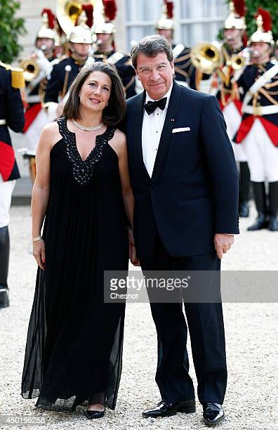 Xavier Darcos and his wife Laure Darcos arrive at the Elysee Palace for a State dinner in honor of Queen Elizabeth II hosted by French President...