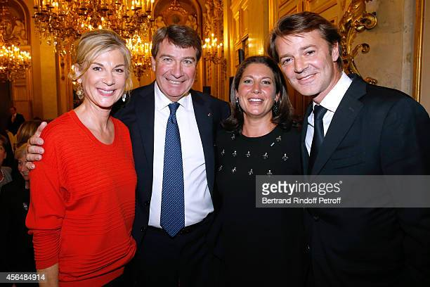 Xavier Darcos and his wife Laure Darcos standing between Francois Baroin and his companion Michele Laroque attend Xavier Darcos receives 'L'Epee...