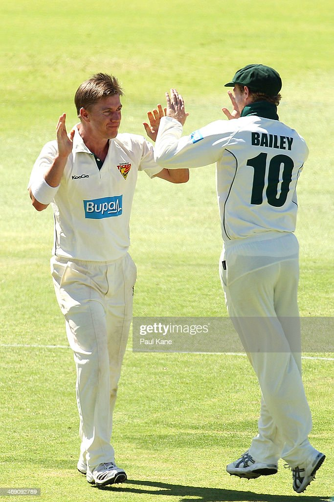 <a gi-track='captionPersonalityLinkClicked' href=/galleries/search?phrase=Xavier+Doherty&family=editorial&specificpeople=2098624 ng-click='$event.stopPropagation()'>Xavier Doherty</a> and George Bailey of the Tigers celebrate the wicket of Mitchell Marsh of the Warriors during day two of the Sheffield Shield match between the Western Australia Warriors and Tasmania Tigers at the WACA on February 13, 2014 in Perth, Australia.