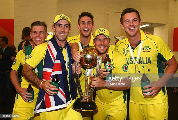 Xavier Doherty Glenn Maxwell Mitch Marsh Aaron Finch and Josh Hazlewood of Australia pose with the trophy in the chnage rooms after the 2015 ICC...