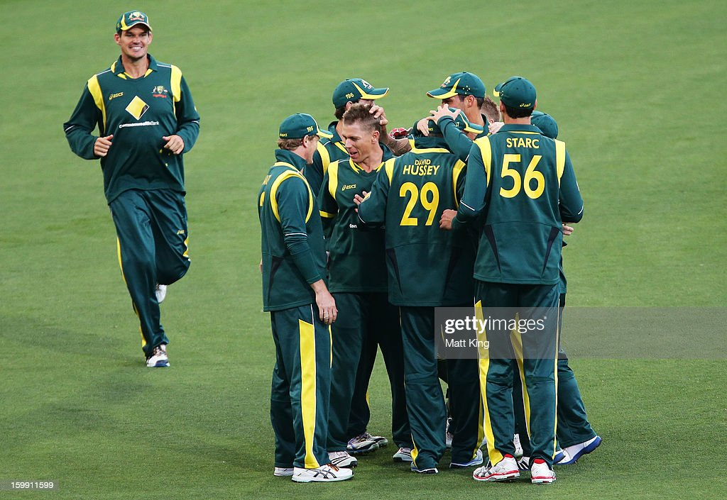 Xavier Doherty (C) of Australia celebrates with team mates after taking the wicket of Lahiru Thirimanne of Sri Lanka during game five of the Commonwealth Bank One Day International series between Australia and Sri Lanka at Blundstone Arena on January 23, 2013 in Hobart, Australia.