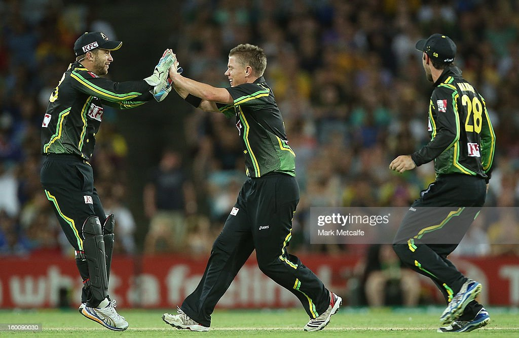 Xavier Doherty of Australia celebrates with teammate Matthew Wade after taking the wicket of Mahela Jayawardena of Sri Lanka during game one of the Twenty20 international match between Australia and Sri Lanka at ANZ Stadium on January 26, 2013 in Sydney, Australia.