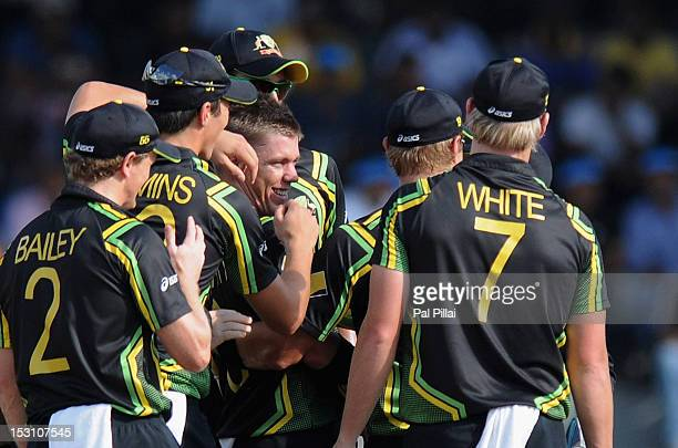 Xavier Doherty of Australia is congratulated by teammates as he claims the wicket of Jacques Kallis of South Africa during the Ninth super eight...