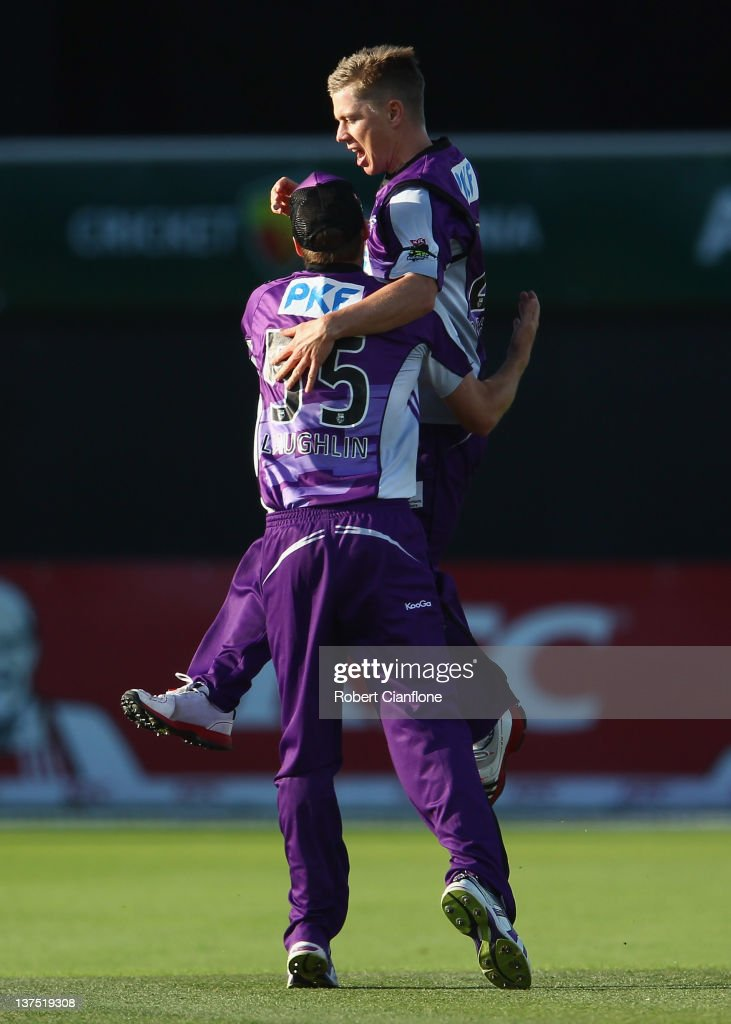 <a gi-track='captionPersonalityLinkClicked' href=/galleries/search?phrase=Xavier+Doherty&family=editorial&specificpeople=2098624 ng-click='$event.stopPropagation()'>Xavier Doherty</a> of the Hurricanes celebrates with Ben Laughlin after taking the wicket of Moises Henriques of the Sydney 6ers during the T20 Big Bash League Semi Final match between the Hobart Hurricanes and the Sydney Sixers at Blundstone Arena on January 22, 2012 in Hobart, Australia.