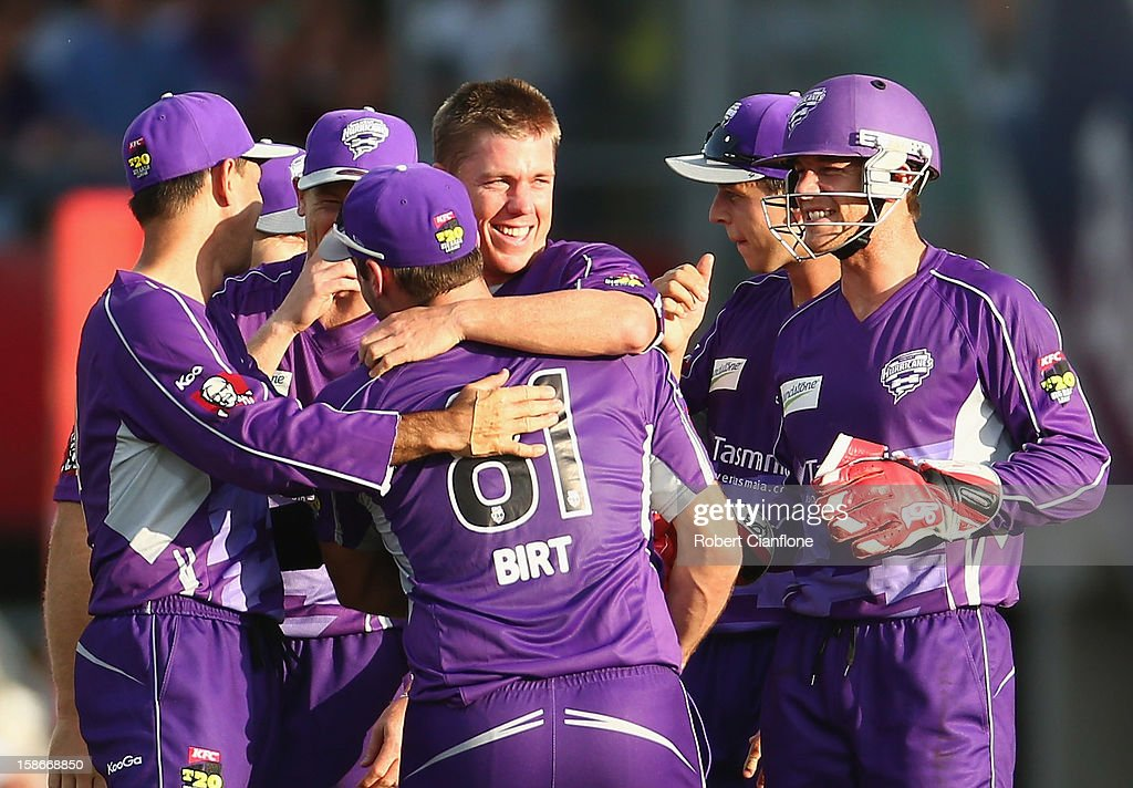 <a gi-track='captionPersonalityLinkClicked' href=/galleries/search?phrase=Xavier+Doherty&family=editorial&specificpeople=2098624 ng-click='$event.stopPropagation()'>Xavier Doherty</a> of the Hurricanes celebrates with team mates after taking a hat trick during the Big Bash League match between the Hobart Hurricanes and the Sydney Thunder at Blundstone Arena on December 23, 2012 in Hobart, Australia.