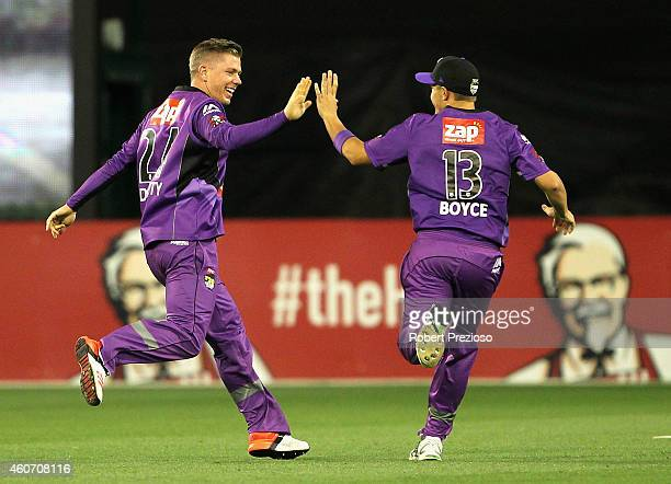 Xavier Doherty of the Hurricanes celebrates with teammate Cameron Boyce after taking the wicket of Cameron White of the Stars during the Big Bash...