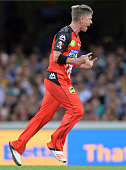 Xavier Doherty of the Renegades celebrates taking the wicket of Lendl Simmons of the Heat during the Big Bash League match between the Brisbane Heat...