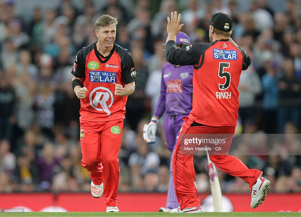 <a gi-track='captionPersonalityLinkClicked' href=/galleries/search?phrase=Xavier+Doherty&family=editorial&specificpeople=2098624 ng-click='$event.stopPropagation()'>Xavier Doherty</a> of the Renegades celebrates with team mate <a gi-track='captionPersonalityLinkClicked' href=/galleries/search?phrase=Aaron+Finch+-+Cricket+Player&family=editorial&specificpeople=724040 ng-click='$event.stopPropagation()'>Aaron Finch</a> after taking the wicket of Tim Paine of the Hurricanes during the Big Bash League match between the Hobart Hurricanes and the Melbourne Renegades at Blundstone Arena on January 4, 2016 in Hobart, Australia.