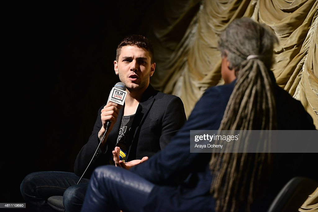 Xavier Dolan and Elvis Mitchell attend the Film Independent at LACMA screening and Q&A of 'Mommy' at Bing Theatre At LACMA on January 6, 2015 in Los Angeles, California.