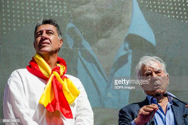 Xavier Garcia Albiol leader of the opposition Spanish beside the writer Vargas Llosa seen during the reading of proclamations Massive demonstration...