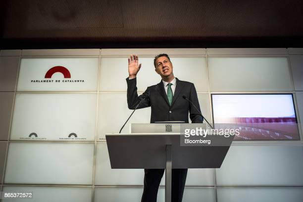 Xavier Garcia Albiol spokesman of the People's Party in the Catalan Parliament gestures as he speaks during a news conference inside the Generalitat...