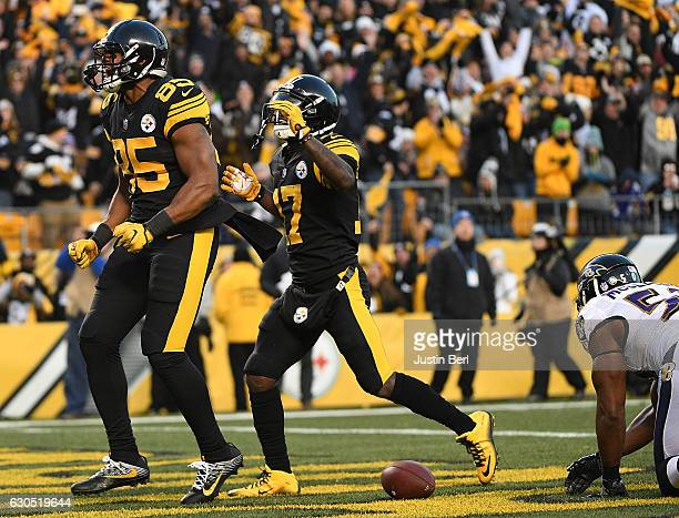 Xavier Grimble of the Pittsburgh Steelers reacts after a 20 yard touchdown reception in the first quarter during the game against the Baltimore...