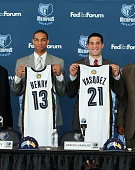 Xavier Henry and Greivis Vasquez the Memphis Grizzlies pose with their jerseys during a press conference to introduce the draft picks on June 25 2010...