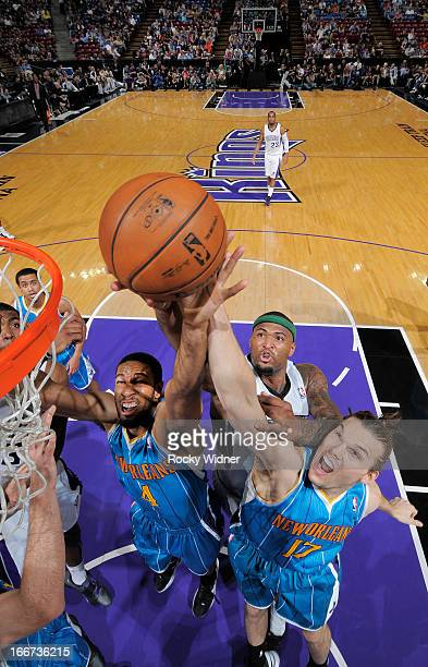 Xavier Henry and Lou Amundson of the New Orleans Hornets battles for the rebound against DeMarcus Cousins of the Sacramento Kings on April 10 2013 at...