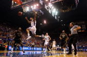 Xavier Henry of the Kansas Jayhawks is fouled as he goes up for a dunk on a fast break during the game against the Missouri Tigers on January 25 2010...