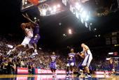 Xavier Henry of the Kansas Jayhawks shoots over Kevin Murphy of the Tennessee Tech Golden Eagles during the game on November 27 2009 at Allen...