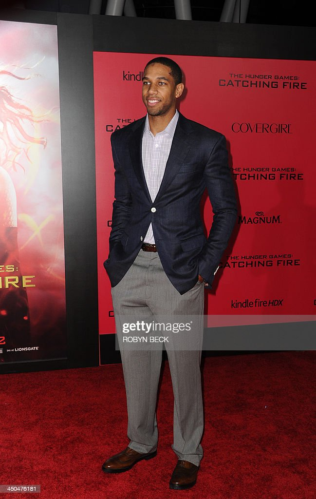 Xavier Henry of the Los Angeles Lakers arrives for the Los Angeles premiere of 'The Hunger Games: Catching Fire' at the Nokia Theatre LA Live in Los Angeles, California, November 18, 2013. AFP PHOTO / Robyn Beck