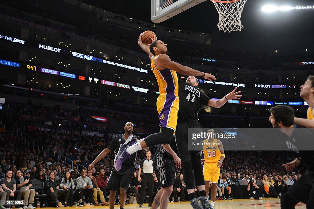 Xavier Henry of the Los Angeles Lakers attempts a dunk against Kevin Love of the Minnesota Timberwolves at Staples Center on December 20 2013 in Los...