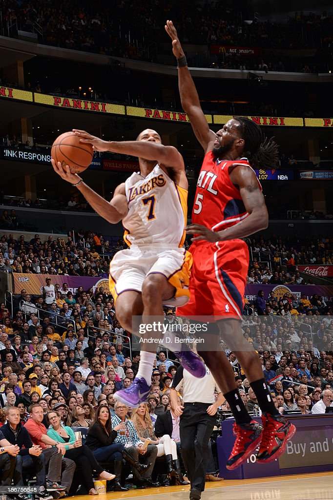 Xavier Henry #7 of the Los Angeles Lakers attempts a shot against DeMarre Carroll #5 of the Atlanta Hawks on November 3, 2013 at STAPLES Center in Los Angeles, California.