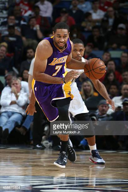Xavier Henry of the Los Angeles Lakers brings the ball up court against the New Orleans Pelicans on November 12 2014 at the Smoothie King Center in...