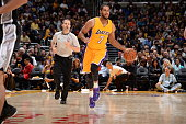 Xavier Henry of the Los Angeles Lakers brings the ball up court against the San Antonio Spurs on November 14 2014 at Staples Center in Los Angeles...
