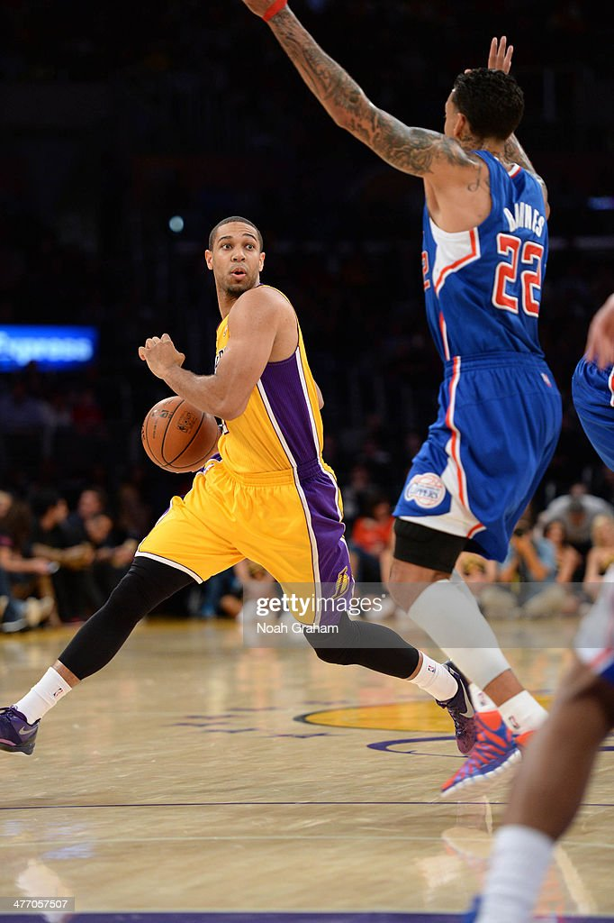 Xavier Henry of the Los Angeles Lakers dribbles against the Los Angeles Clippers at Staples Center on March 6 2014 in Los Angeles California NOTE TO...