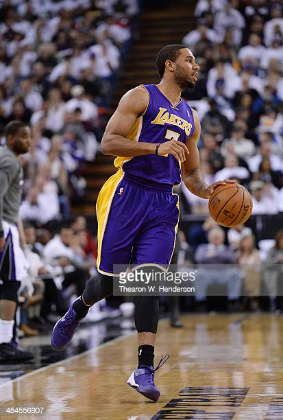 Xavier Henry of the Los Angeles Lakers dribbles the ball against the Sacramento Kings at Sleep Train Arena on December 6 2013 in Sacramento...